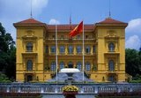 The Presidential Palace was originally constructed in 1901 for Paul Doumer, then Governor of French Indochina. Painted in the dark mustard yellow stonework with the green windows and louvered shutters so favoured in Vietnam, it is now chiefly employed to receive visiting dignitaries and heads of state.<br/><br/>  Vietnamese national hero, Ho Chi Minh, who became President of the Democratic Republic of Vietnam in 1954, declined to live here. According to his biographer Duiker: 'he refused an offer by his colleagues to live in the Governor-General's Palace, which he considered to be too pretentious for his tastes, and decided to take up residence in a small gardener's house on the palace grounds'.